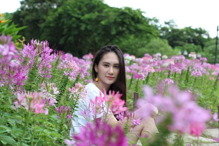 Flower Plant Nature One Person Growth Tranquility Young Women Beauty In Nature Outdoors Black Hair Selective Focus Smelling One Woman Only Adult Only Women Purple Day Front View Women Young Adult