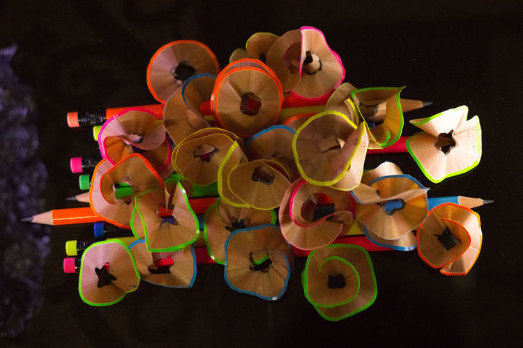 Close-Up Of Colorful Pencil Shavings On Table