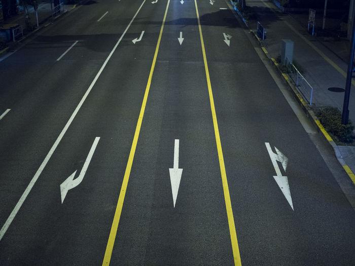 Yellow arrow symbol on road