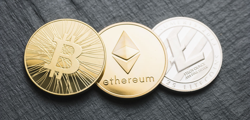 cryptocurrencys coins Bitcoin, Ethereum, Litecoin on a slate Anonymous Business Currency Economy Gold Market Trading Virtual Bit-coin Bitcoin Coin Concept Crypto Cryptography Ether Ethereum Exchange Finance Financial Internet Litecoin Money Notebook Slate Symbol