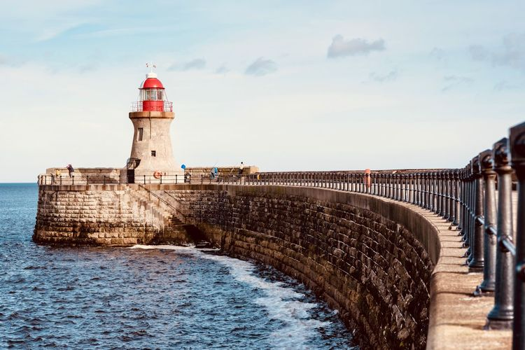 South Shields lighthouse Fisherman Nikon Pier Nikonphotography EyeEm Gallery EyeEm Masterclass Lighthouse Built Structure Architecture Building Exterior Sky Water Building Lighthouse Beach Travel Day Direction Protection Security Cloud - Sky Nature Guidance Sea Safety