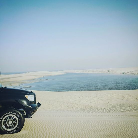 Desert Beauty Deserts Around The World Desrt Safari Tranquil Scene Beach Sand Sea Nature Horizon Over Water Beauty In Nature Scenics Tranquility Day Sky Clear Sky Outdoors Water No People Vacations Sand Dune Qatar Qatarlife