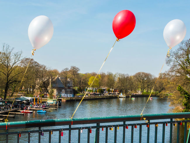 Balloon Mid-air Water Helium Balloon Flying Sky Day No People Outdoors Nature Multi Colored Bridge - Man Made Structure Tradition Love Luck