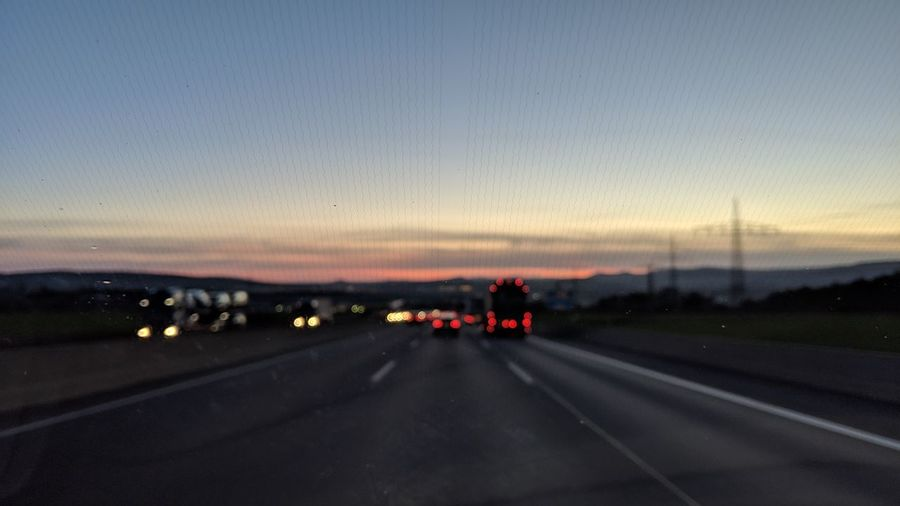 Driving through Germany. Germany Highway Freeway Autobahn Driving From A Car Window Ahead The Way Forward Driving Home Colors Glitch Blurry Romantic Scenics Urban Romantic Modern Life Sunset Road Journey Dusk Sky Travel
