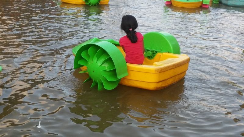 Water High Angle View Rear View Childhood Floating On Water Nautical Vessel Beach Real People Child Boys Outdoors Males  One Person Day Sand Pail And Shovel . People Boating