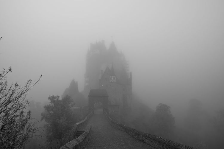 Autumn Eltz Castle Spooky Atmosphere Architecture Beauty In Nature Built Structure Fog Foggy Germany Mist Misty Eltz Castle Outdoors Scenics Spooky Spooky Castle Tranquility Travel Destinations