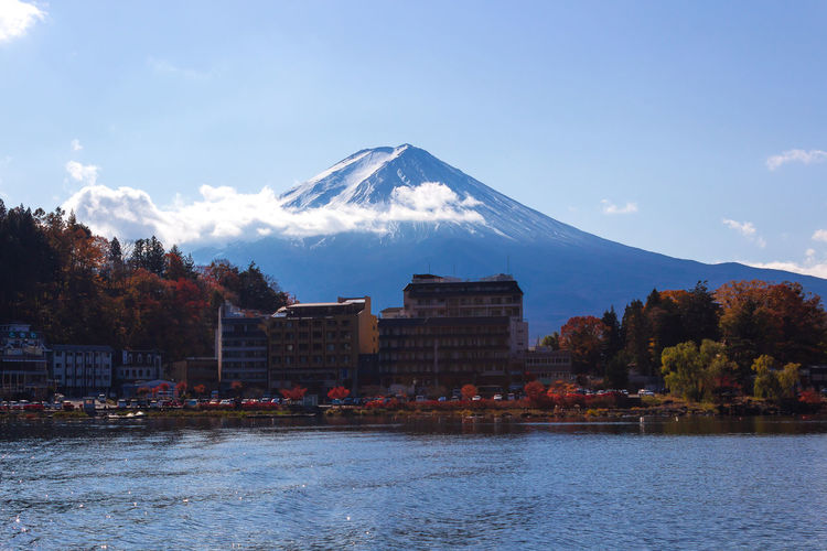 Autumn EyeEmNewHere Fujisan Japan Nature Architecture Beauty In Nature Built Structure Change Cloud - Sky Day Lake Leaf Mountain Mountain Range Nature No People Outdoors Scenics - Nature Sky Snowcapped Mountain Travel Destinations Tree Water Waterfront