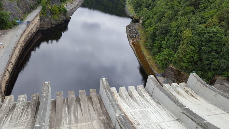 High angle view of dam by lake