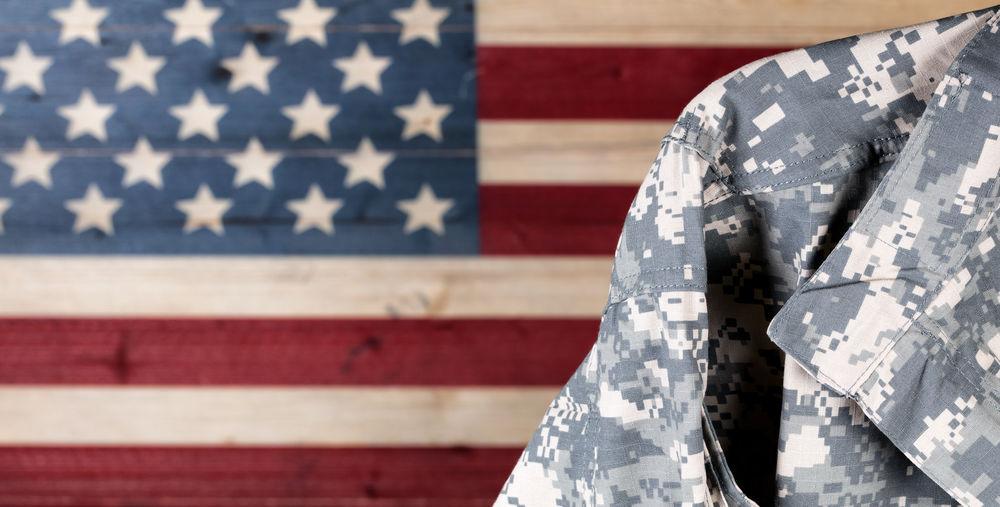 Military Uniform Against American Flag
