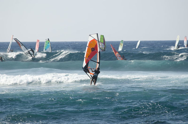 Hawaii Hookipa Maui Adventure Aquatic Sport Balance Beauty In Nature Day Extreme Sports Freedom Horizon Over Water Leisure Activity Lifestyles Motion Nature Outdoors Real People Sea Skill  Sky Sport Water Waterfront Wave Windsurfing