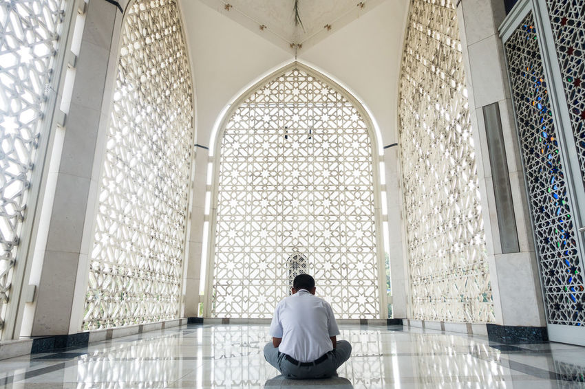 Muslim Man Praying at a Mosque. Reflection of Islamic Architecture and Motifs. EyeEm Best Edits EyeEm Best Shots Faith Place Of Worship Pray Adult Architecture Day Indoors  Islam Islamic Architecture Men Mosque One Person People Real People Rear View Reflection, Religion Sitting Spirituality Wellbeing