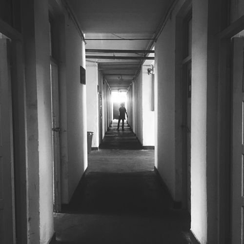 EyeEmNewHere Lonely Architecture Blackandwhite Built Structure Chill Corridor Day Full Length Indoors  Men People Real People The Way Forward Thrill