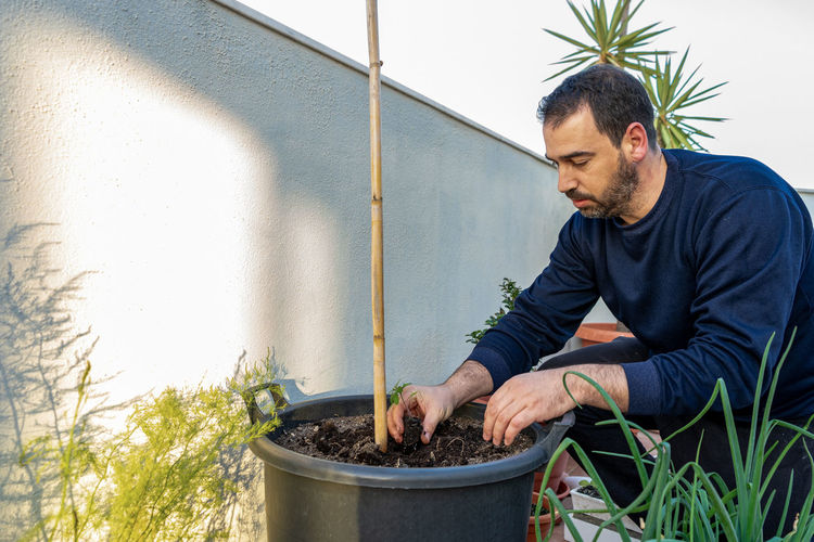 Man working by plant