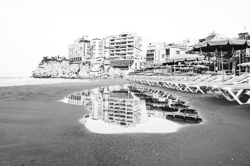 Benidorm Reflections Beach Architecture Sea Built Structure Building Exterior Sand Outdoors City Day Travel Destinations Modern Benidorm Clear Sky No People Water Nature Cityscape Sky