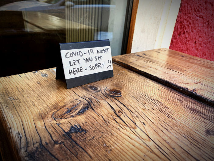 High angle view of text on wooden table