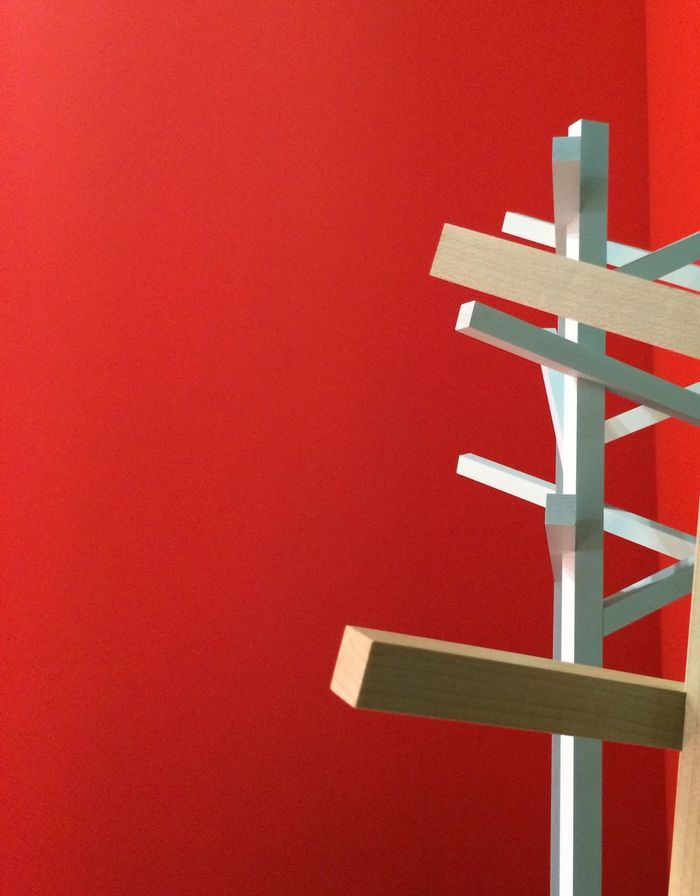 Close-up of frame against red wall