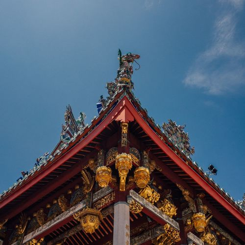Low angle view of statue of temple against sky