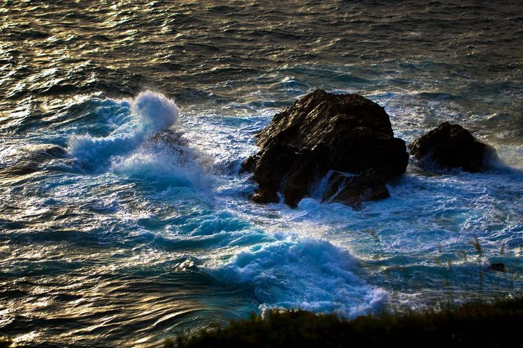 Waves breaking on a rock, as seen from the Temple of Poseidon. Sea Wave Motion Water Beauty In Nature Sport Power In Nature Power Nature Rock Land Day Scenics - Nature Rock - Object Outdoors Hitting Breaking Wave Waves Waves, Ocean, Nature Waves Crashing Waves And Rocks Wind