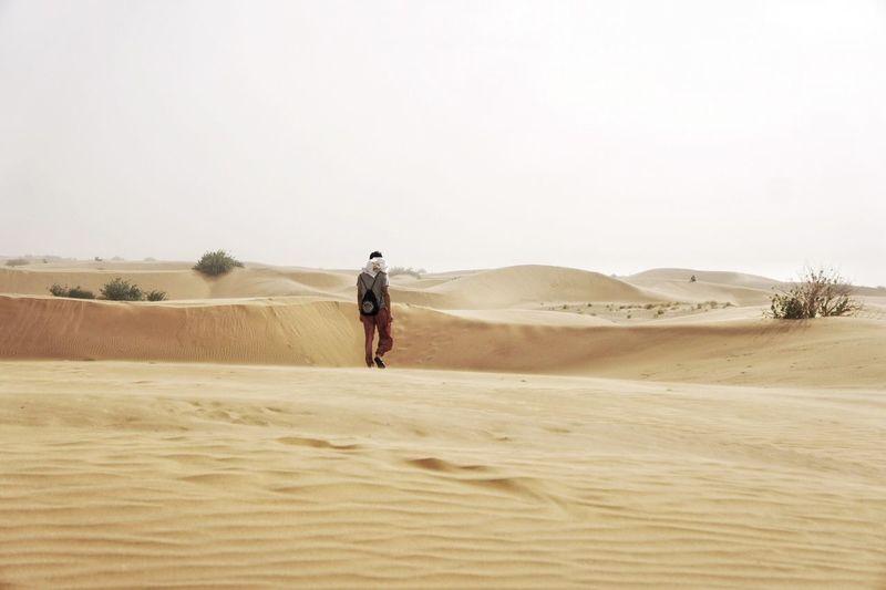 Full Length Of Man Walking At Desert
