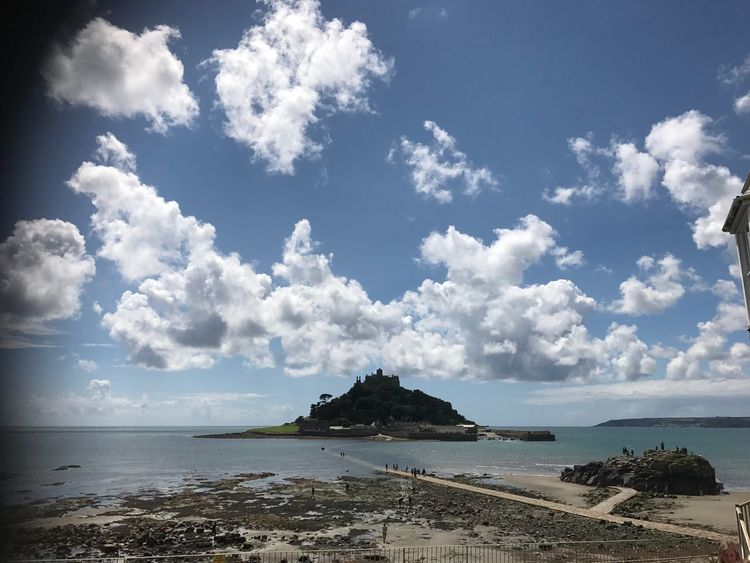 St Michaels mount sea island view Beach Tide Out Tide In Sandy Sand Tranquil Isolated Island Sea Peace Mood Blue Sky