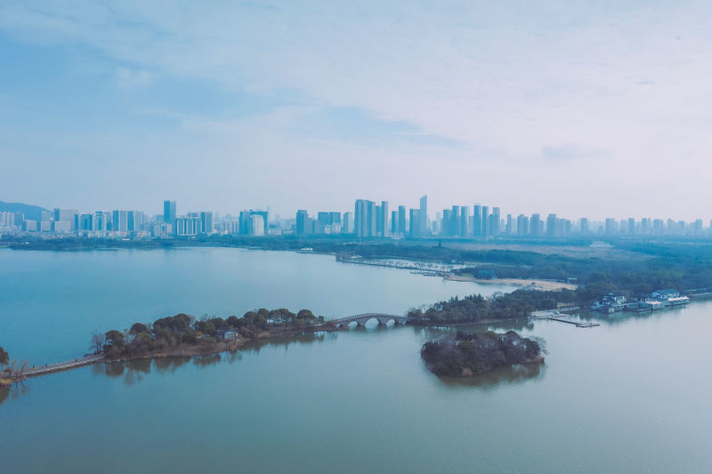 Spring in Jiangnan Water Village, China China ASIA Landscape Nature Beauty In Nature Outdoors Sea Sky Building Exterior Architecture Built Structure City Water Building Cityscape Waterfront Office Building Exterior Skyscraper Urban Skyline Cloud - Sky Day Financial District  Panoramic