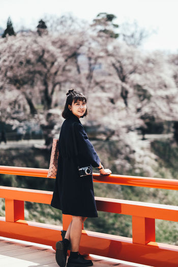 Sakura One Person Real People Lifestyles Full Length Railing Plant Standing Young Adult Women Leisure Activity Tree Focus On Foreground Day Nature Young Women Clothing Fashion Architecture Outdoors Contemplation Beautiful Woman Hairstyle Sakura Sakura Blossom Sakura Trees