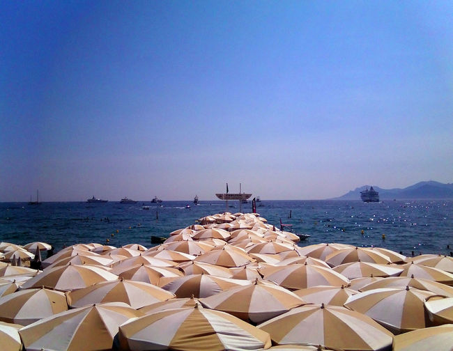 Water Sky Sea Clear Sky Copy Space Day Nature Scenics - Nature Beauty In Nature Tranquility No People Sunlight Land Blue Tranquil Scene Beach Architecture Outdoors Nautical Vessel Parasols Cannes Summer