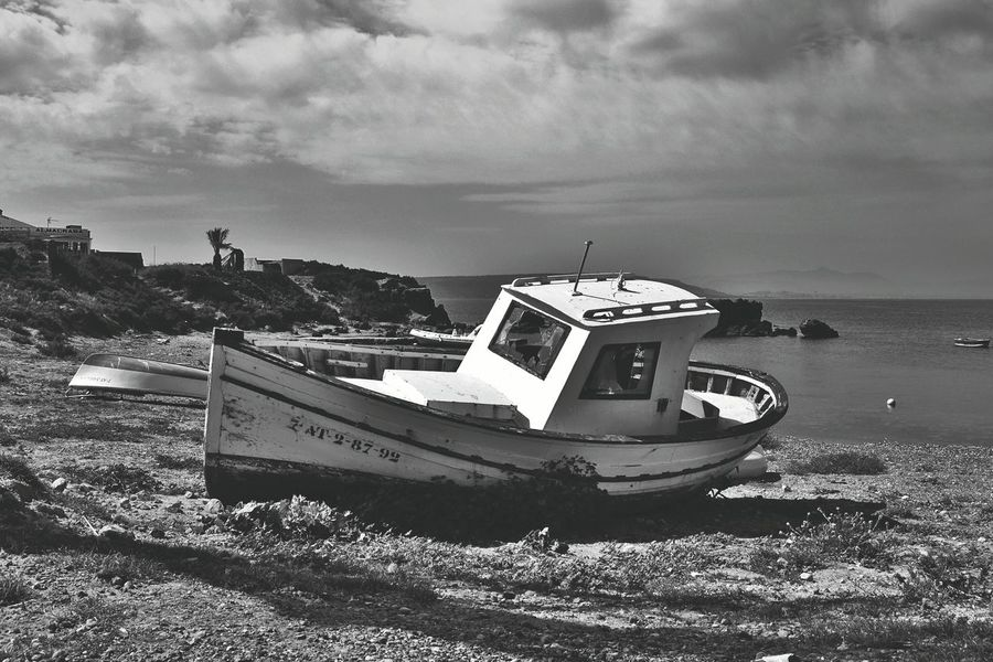 Beach Photography Relaxing Hi! Beachphotography Tied Boat Sea Fishermen Fisherman Tranquility Scene Nobody Boat Place Of Interest Alicante, Spain Beach Tranquility Tabarca Island Boats Tabarca's Island SPAIN Islandlife Relaxing Alicante Blackandwhite Black And White