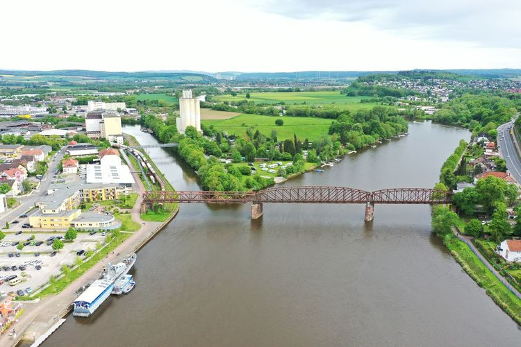 High angle view of bridge over river amidst buildings in city