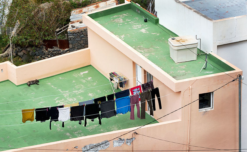 High Angle View Of Laundry Hanging On Terrace