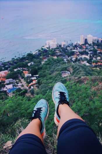 dangle at higher heights Views Plants Hawaii Ocean Ocean View Coastline Island Colors Personal Perspective Low Section Shoe Human Leg Human Body Part Body Part Real People One Person Nature High Angle View Lifestyles Day Water Land Sea Outdoors