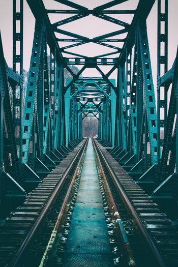 Bridge over troubled water The Photojournalist - 2018 EyeEm Awards Architecture Bridge Bridge - Man Made Structure Built Structure Ceiling Connection Day Diminishing Perspective Direction Empty Iron - Metal Long Metal No People Outdoors Rail Transportation Railroad Track Railway Bridge The Way Forward Track Transportation vanishing point The Architect - 2019 EyeEm Awards