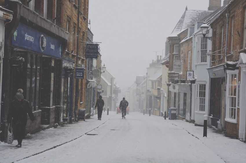 """Blizzard conditions with heavy snow during """"Storm Emma"""", most shops are closed in Cheap Street on what would normally be a very busy weekday afternoon. 1 March 2018 Snowing Freezing Freezing Cold Unseasonable Weather Cold Weather Extreme Cold Snowing Blizzard Blizzard 2018 Storm Emma Architecture Winter Snow Building Exterior Built Structure Cold Temperature Walking Real People Full Length Men Outdoors City Day Nature Warm Clothing People"""