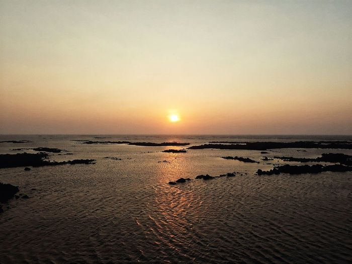 Adapted To The City The Sea Rushing To Shore City Beach Rocky Pool Sunset Reflection Beauty In Nature Tranquility Horizon Over Water