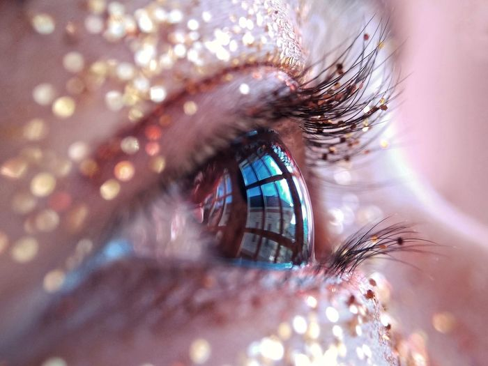 Extreme close-up of woman eye with glitter