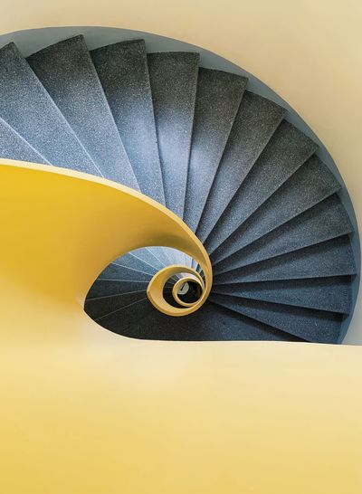 ShotOnIphone The Week on EyeEm Indoors  Spiral No People Close-up Pattern Spiral Staircase Yellow Architecture Staircase Steps And Staircases Day High Angle View
