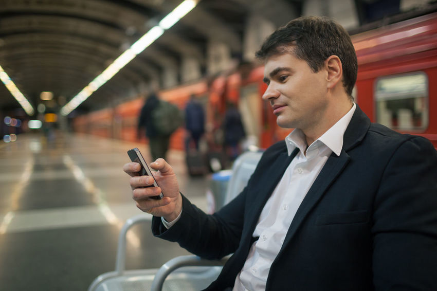 Businessman Businesspeople Caucasian Cellphone Horizontal Man Message Metro Mobile Passenger Phone Smart Phone SMS Station Subway Transport Type Underground