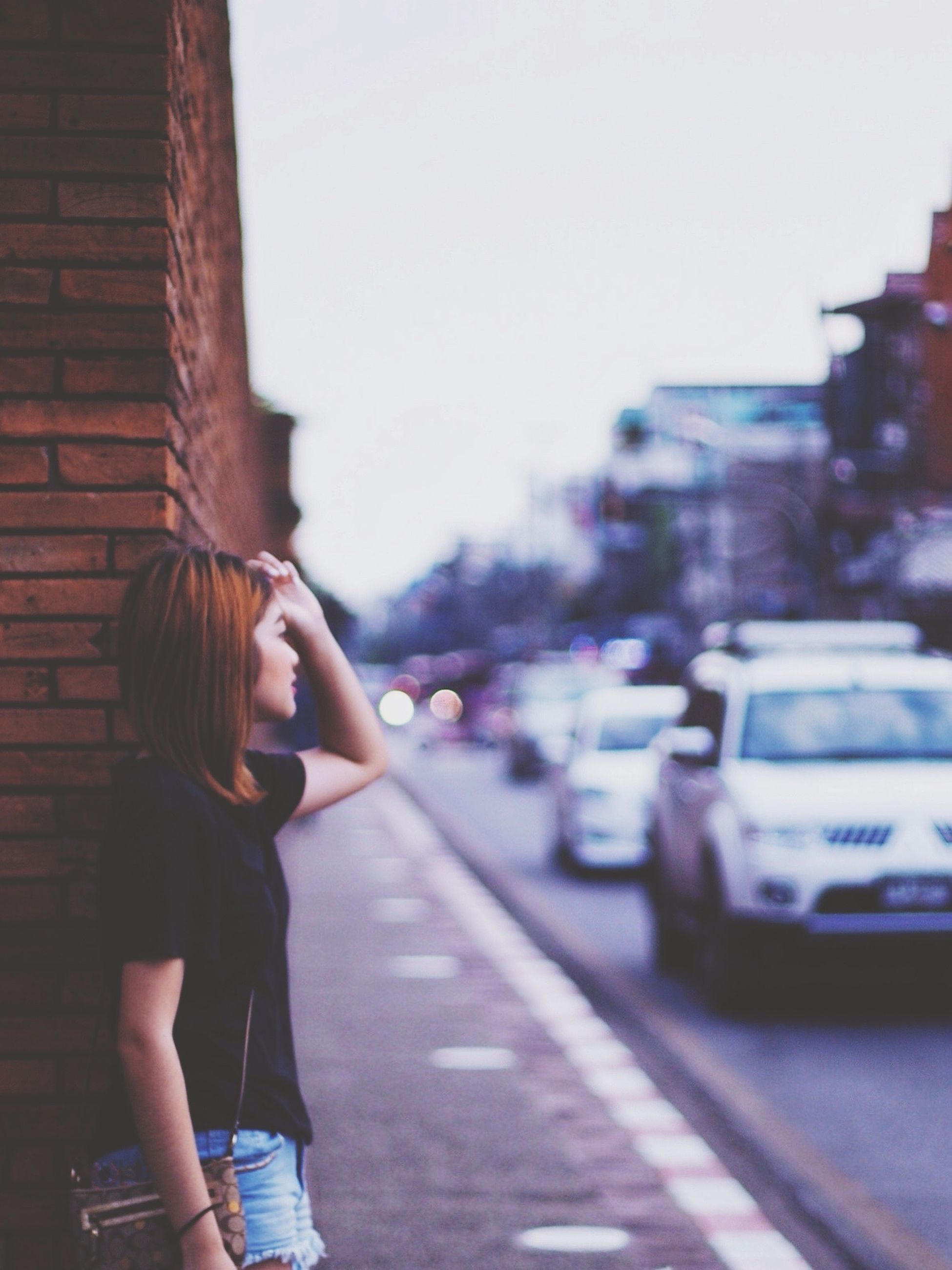 car, street, road, transportation, young women, land vehicle, city, long hair, young adult, city life, mode of transport, casual clothing, focus on foreground, medium-length hair, day, holding, person, outdoors