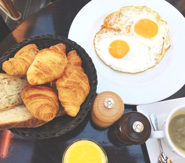 High angle view of egg and croissants on table