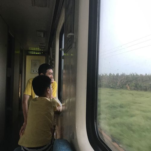 Transportation Journey Train - Vehicle Window Public Transportation Passenger Sitting Travel Real People Mode Of Transport Looking Through Window Indoors  Airplane One Person Day People