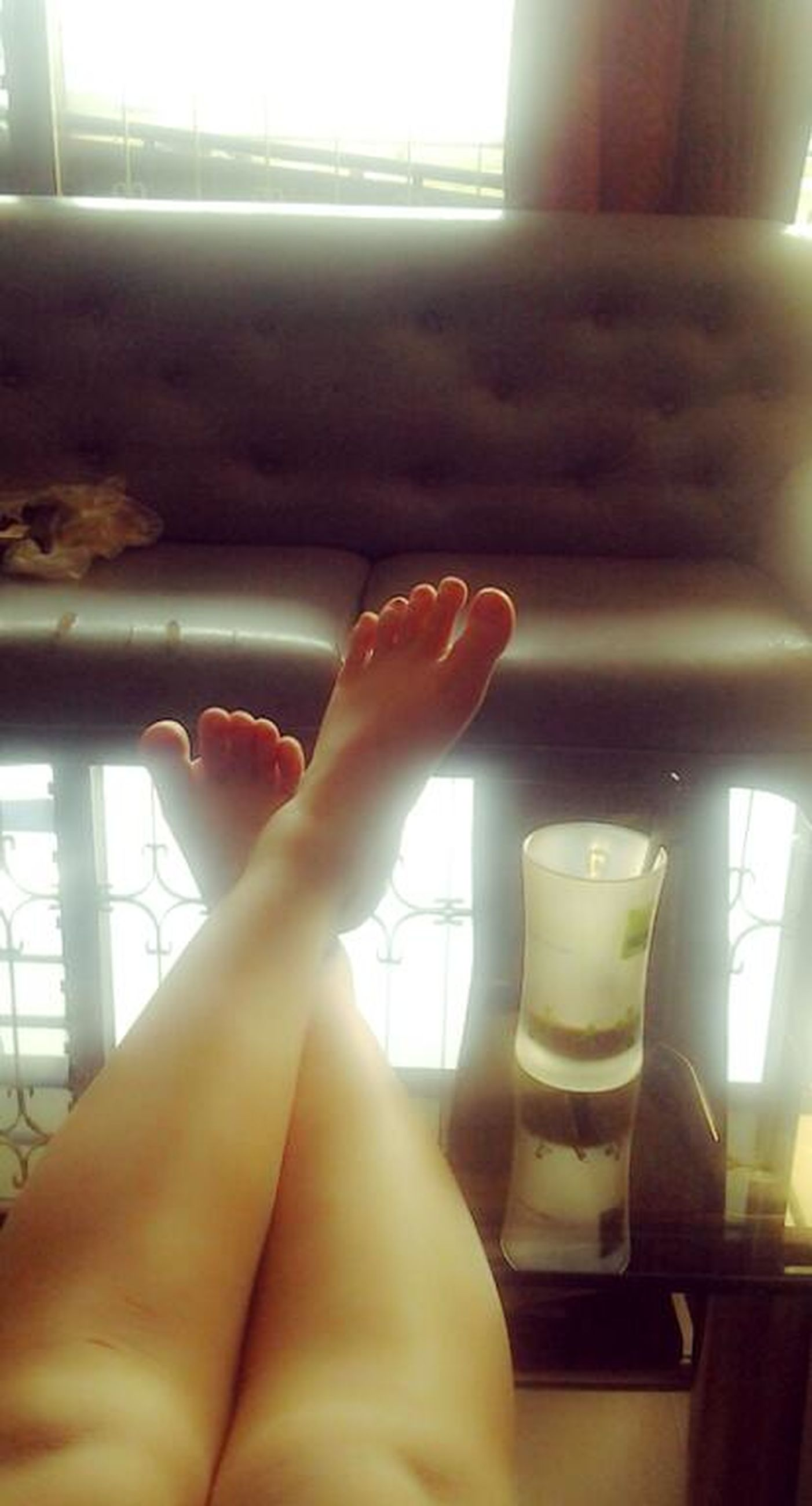 indoors, person, personal perspective, lifestyles, window, part of, home interior, low section, domestic room, human finger, barefoot, relaxation, cropped, sunlight, leisure activity