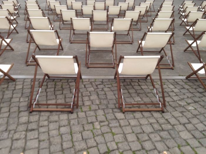 High Angle View Of Empty Chairs In Rows