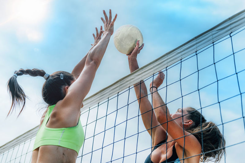 Beach volleyball players at the net