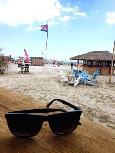 Flag Sunglasses Sea Beach Water Sky Sand Cloud - Sky Day Nautical Vessel Vacations Outdoors Tourism Patriotism Summer Nature No People Travel Destinations