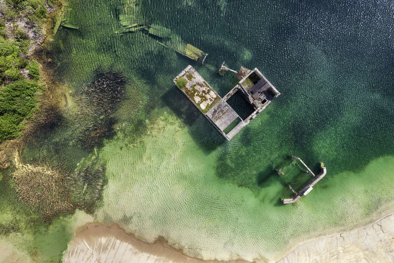 High angle view of house by sea