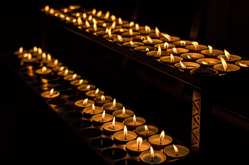 Candles in a dark room Abundance Arrangement Burning Candle Candlelight Candles Church Conformity Dark Darkness Darkness And Light Decoration First Eyeem Photo Flame Glowing In A Row Indoors  Large Group Of Objects Place Of Worship Religion Religious Offering Repetition Shadow