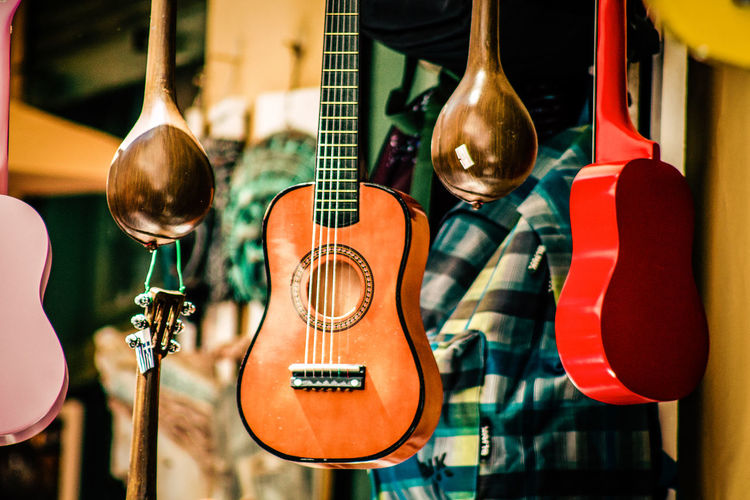 Close-up of guitars for sale