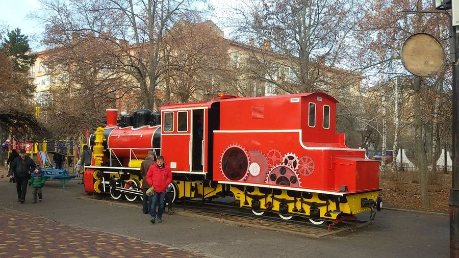 Red Transportation Tree Mode Of Transport Land Vehicle Outdoors No People Day Sky Sreetphotography Children At Play Children Park Steam Locomotive Trainphotography Old Locomotive The Purist (no Edit, No Filter) The Places I've Been Today Trees And Sky