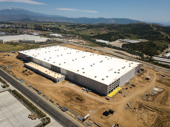 Beaumont, CA / USA - 4/20/2019: Overhead view of a new Amazon Fulfillment Center under construction. High Angle View Day Architecture Built Structure No People Outdoors Construction Construction Site Warehouse Distribution Logistics Equipment New Building  Amazon Overhead View Mountain Environment Landscape Nature Sky Transportation Building Exterior Road Scenics - Nature Land Vehicle Industry Mode Of Transportation Land Sunlight Pollution