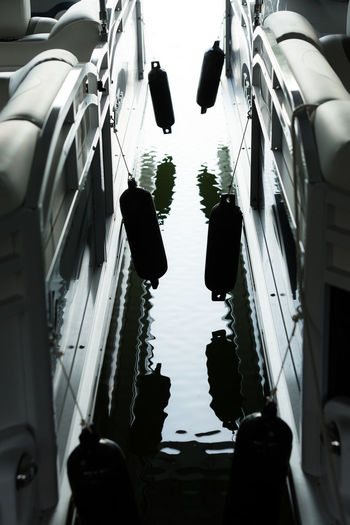 Between Boats Boya Directly Below Light And Shadow Long Low Angle View Mode Of Transport No People Outdoors Reflection Symetry Transportation
